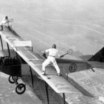 "25 Oct 1925, Los Angeles, California, USA --- Original caption: Gladys Roy, who gets her fun out of doing unusual things with airplanes, also likes to play tennis. Ivan Unger (member of the ""Flying Black Hats"") is her opponent. Frank Tomac is the pilot who keeps the plane at 3,000 feet. The only problem with this match is trying to retrieve a ball after it has bounced off the wing of the plane and plunged a few thousand feet. --- Image by © Bettmann/CORBIS"