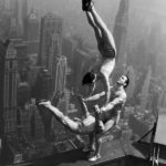 21 Aug 1934, Manhattan, New York City, New York State, USA --- Acrobats Jarley Smith (top), Jewell Waddek (left), and Jimmy Kerrigan (right) perform a delicate balancing act on a ledge of the Empire State Building in Manhattan. --- Image by © Bettmann/CORBIS